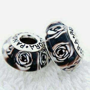 Pandora pair of black and white rose Muranos.
